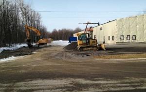 Réalisation d'un entrepôt (déboisement, remplissage, compaction, finition)